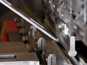 什么是钣金加工中的折弯余量?